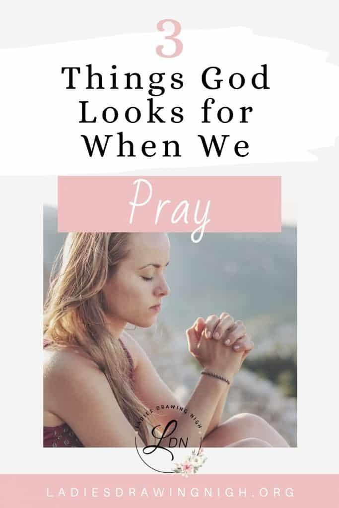 girl sitting on top of mountain praying