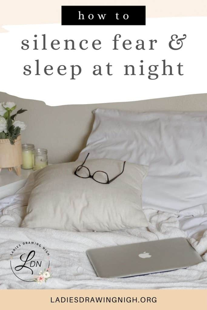 bed glasses on pillow laptop