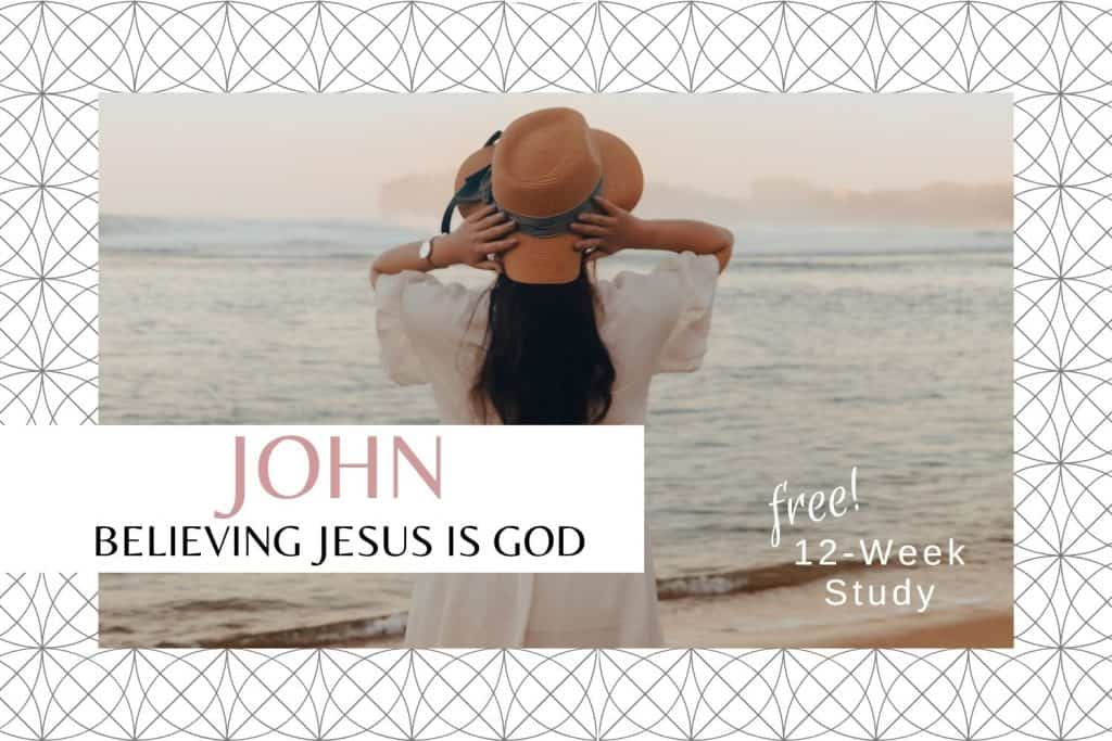 woman beach hands holding hat on head John Bible study