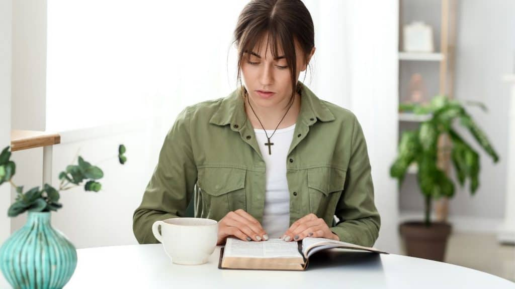 woman table applying 5 Tips to Start Reading the Bible Daily