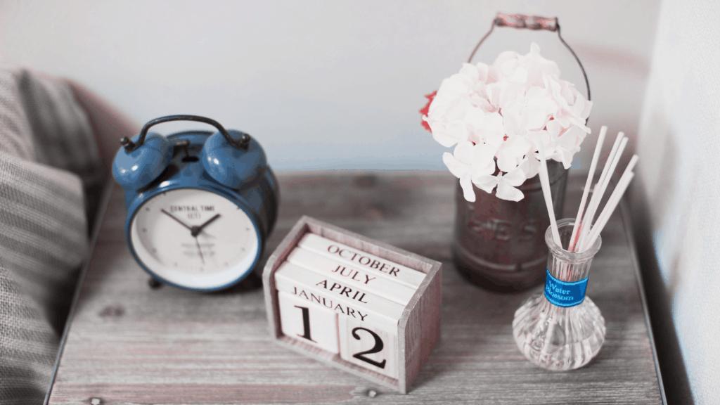 clock wooden block calendar tin flower vase illustrating Bible Verses About Waiting on God